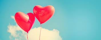 Heart shaped red balloons