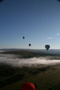 Hot air Balloons Over Clouds